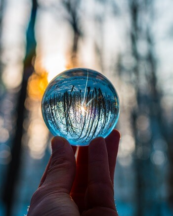 Person Holding A Crystal Ball